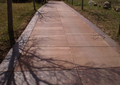 Concrete Driveway Colored Cement and Stamped Boarders in El Paso County, Colorado Built by PSF Company